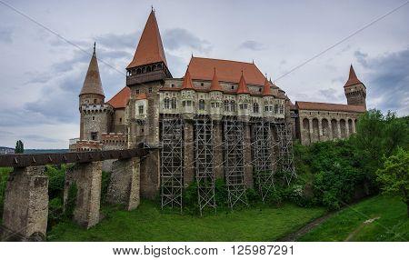 Beautiful panorama of the Corvin castle with wooden bridge and bench Hunedoara, Transylvania, Romania, Europe