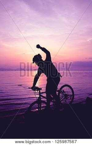 Healthy Lifestyle. Silhouette Of Bicyclist Riding The Bike At Seaside. Outdoors.