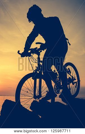 Healthy Lifestyle. Silhouette Of Bicyclist Riding The Bike At Seaside. Outdoors. Vintage Style.