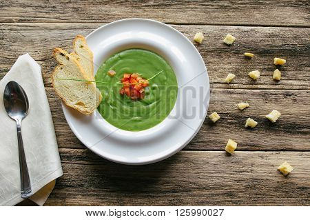 vegetarian food on wooden background. vegetable soup puree with asparagus and broccoli with toasted croutons. healthy vegetarian food from  boiled vegetables