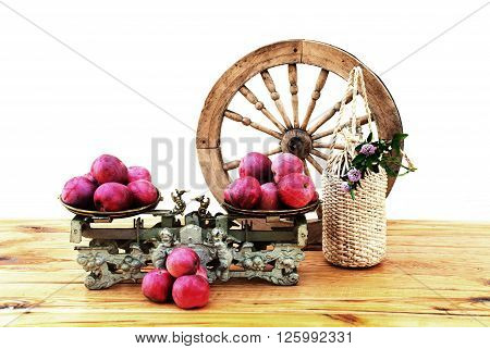 Autumn apples vintage mechanical scales and a bottle of cider on wooden table