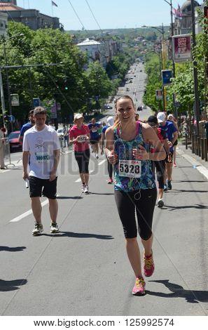 BELGRADE, SERBIA - APRIL 16: An unidentified woman runs in 29th Belgrade Marathon on April 16, 2016 in Belgrade, Serbia