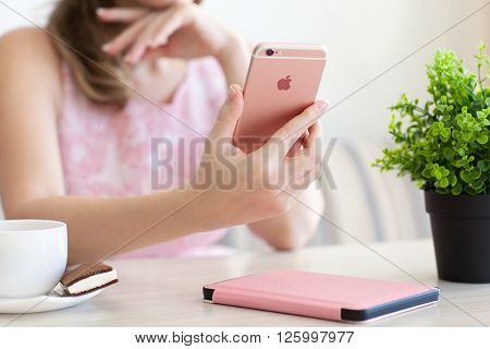 Alushta Russia - October 27 2015: Woman holding in the hand iPhone6S Rose Gold. iPhone 6S Rose Gold was created and developed by the Apple inc.