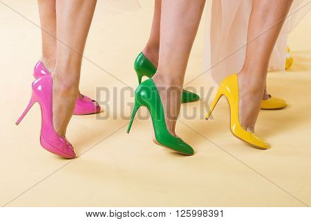 Pretty ladies in bright hight heeled shoes