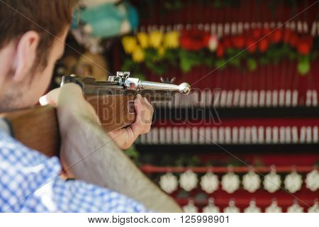 MUNICH, GERMANY - OCTOBER 02: Man at a shooting gallery trying to hit white stars