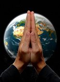 pic of praying hands  - praying hands in front of earth concept - JPG