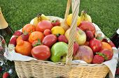 image of tangelo  - A basket of assorted Fruit including the controversial Tomatoes sitting on the grass as though having a picnic - JPG