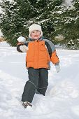 Smiling Boy Throws The Snowball poster