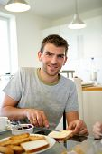 stock photo of matinee  - Portrait of a smiling man having breakfast - JPG