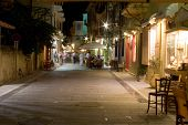 foto of inri  - picturesque houses street cafe in nafplion greece by night  - JPG