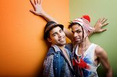 stock photo of sock-monkey  - Two handsome gay young men standing in a corner - JPG