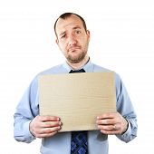 stock photo of pity  - Businessman begging for help with cardboard sign - JPG