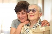 pic of mother daughter  - Happy woman with elderly mother laughing together - JPG