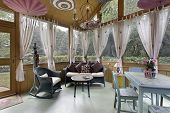 pic of screen-porch  - Porch in luxury home with wihte curtains - JPG