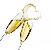 stock photo of champagne glasses  - Two Champagne Glasses with abstract splash - JPG