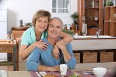 pic of elderly couple  - Portrait of an elderly couple at breakfast - JPG
