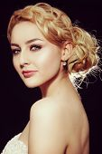Vintage style portrait of young beautiful blond woman with fancy prom hairdo and smoky eyes make-up poster