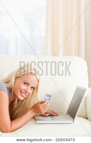 Portrait Of A Smiling Woman Purchasing Online