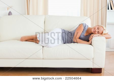 Calm Woman Resting On A Sofa
