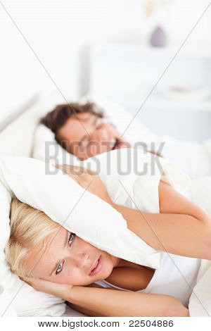 Portrait Of An Unhappy Woman Awaken By Her Fiance's Snoring