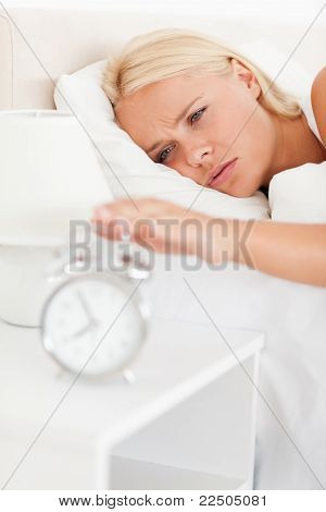 Portrait Of A Woman Awaken By An Alarmclock