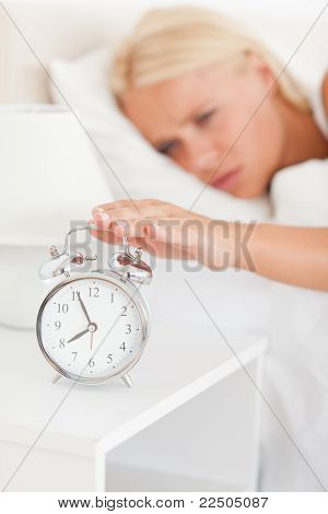 Portrait Of A Blonde Woman Awaken By An Alarmclock