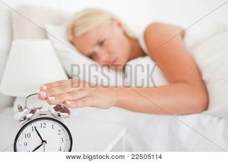 Woman Switching Off Her Alarmclock