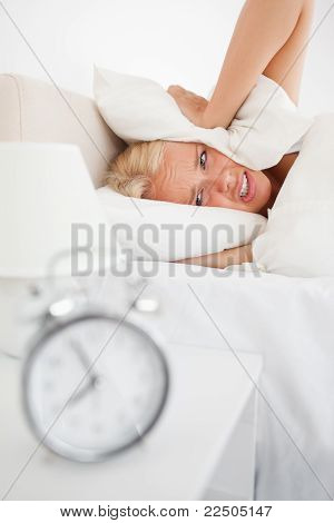 Portrait Of A Tired Woman Hidding Her Head In A Pillow While The