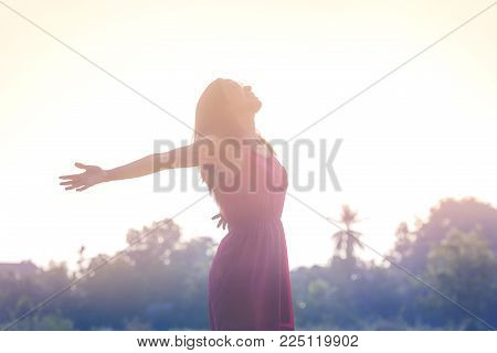 poster of Young beauty woman happy relaxing smile with sunglasses and pink dress cloth in summer sunset sky outdoor. People freedom style.