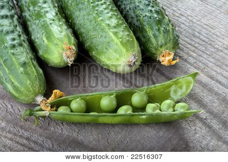 Green Cucumbers And Peas Pod On A Table