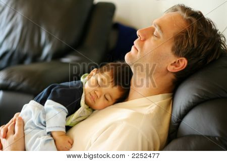 Father Napping With Baby Asleep On His Chest, Focus On Father