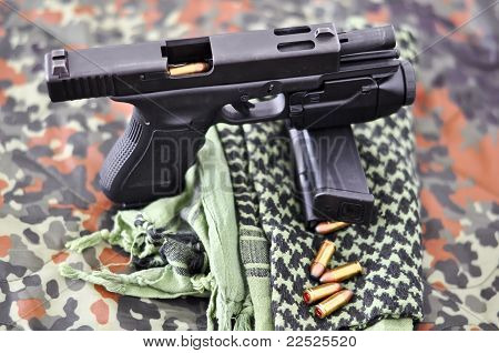 military handgun with a tactical laser/light-module
