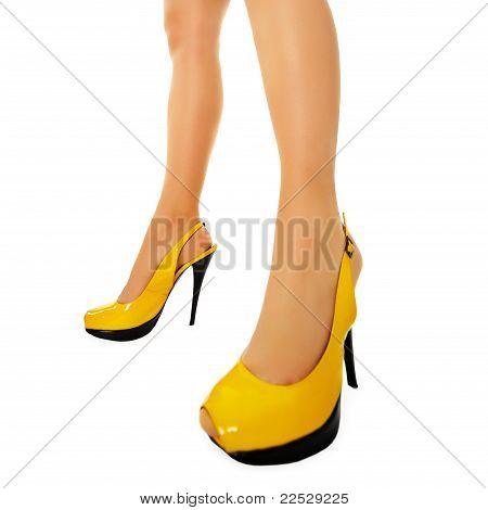 Female Legs In Yellow High Heels