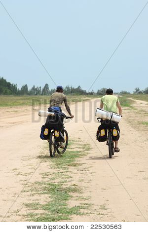 Two Tourists In Bicycle Trip, View From Back