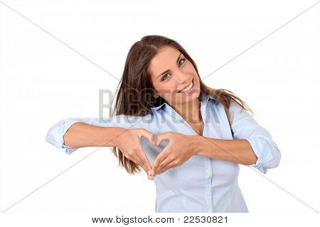 Beautiful woman doing heartshape with hands