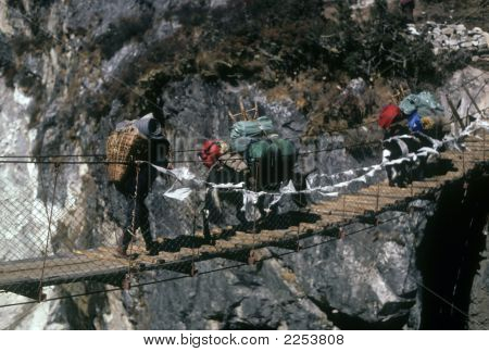 Sherpa And Yak Crossing Suspension Bridge