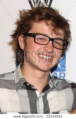 LOS ANGELES - AUG 11:  Angus T. Jones arriving at the