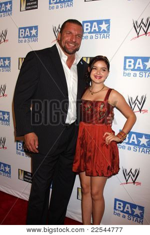 LOS ANGELES - AUG 11:  Triple H, Ariel Winter arriving at the