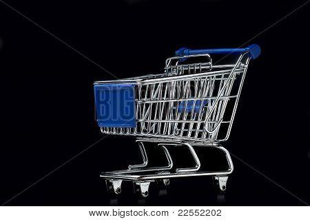Shopping cart on black background