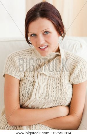 Close up of a smiling young woman in a living room