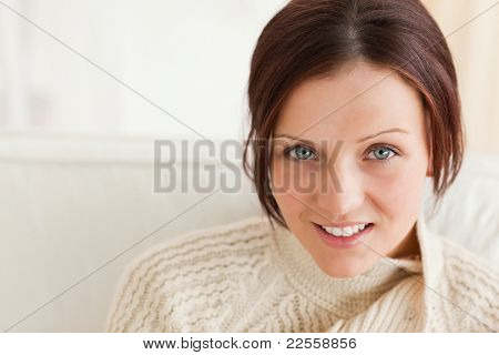 Close up of a cute woman in a living room