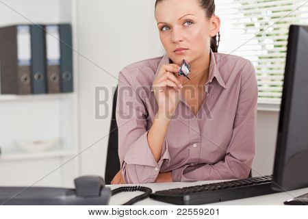 A pensive businesswoman in her office