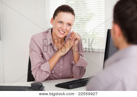 A businesswoman is talking with a customer
