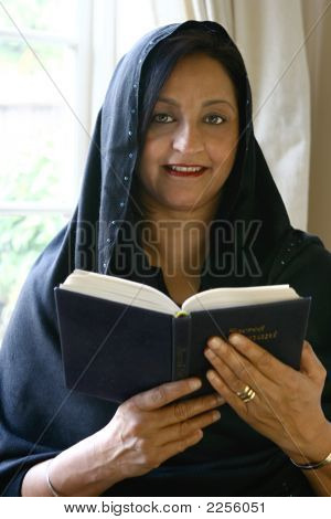 Beautiful Mature Indian Female With Religious Book