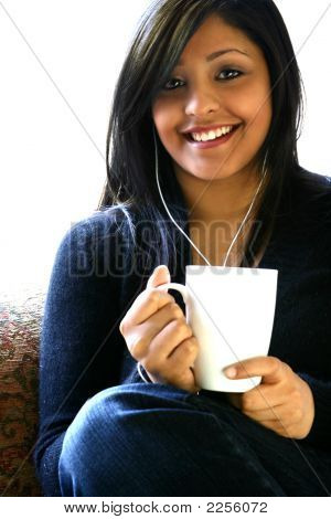 Beautiful Asian Female Relaxing While Listening To Her Mp3
