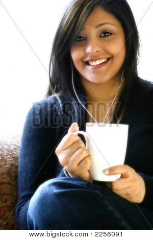 Young Asian Woman Listening To Music With Coffee