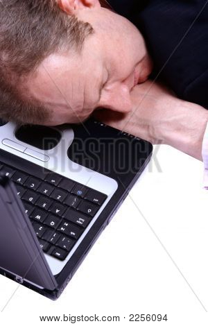 Businessman Asleep On Laptop Isolated On White
