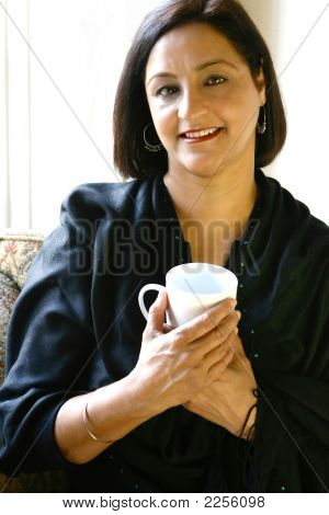 Mature Asian Woman With Cup Of Coffee