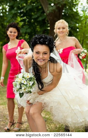 Bridesmaids standing with bride