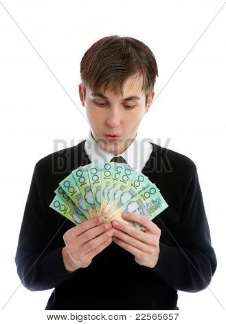 Student Or Young Worker Looking Down At Handful Of Cash